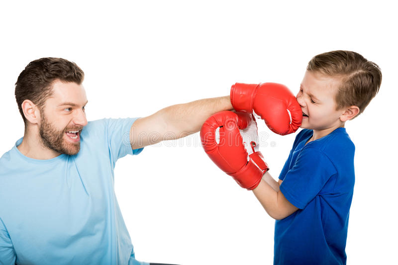 Father with son boxing together isolated on white stock photo