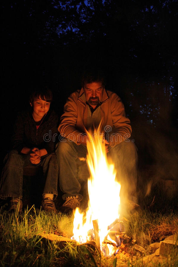 Father and son campfire royalty free stock photos