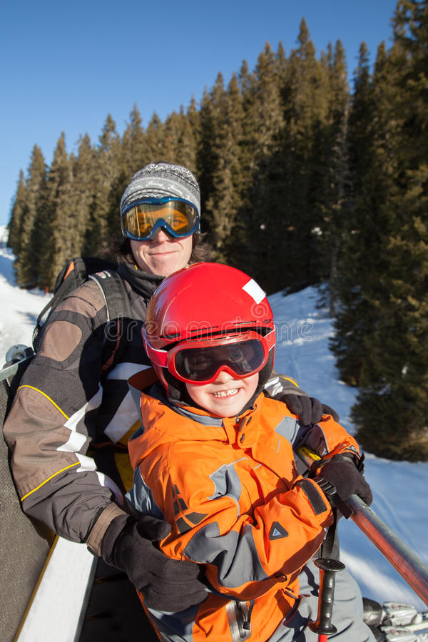 The father with son on chair lift. In mountains, Kitzbuhel, Austria stock images