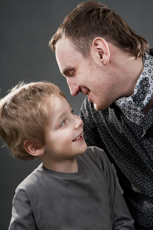 Download Father And Son Cheerfully Talk. Stock Image - Image: 23026997