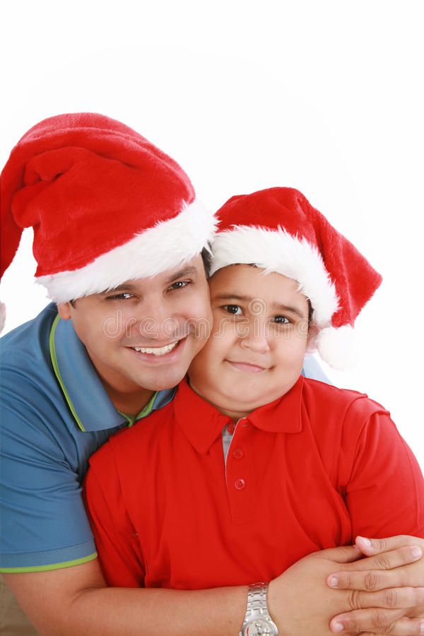 Download Father And Son With Christmas Hats Stock Photos - Image: 21745463