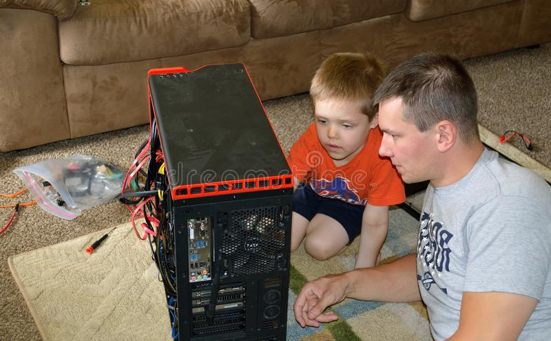 Download Father And Son Computer Repair Stock Photo - Image of idaho, boise: 105488152