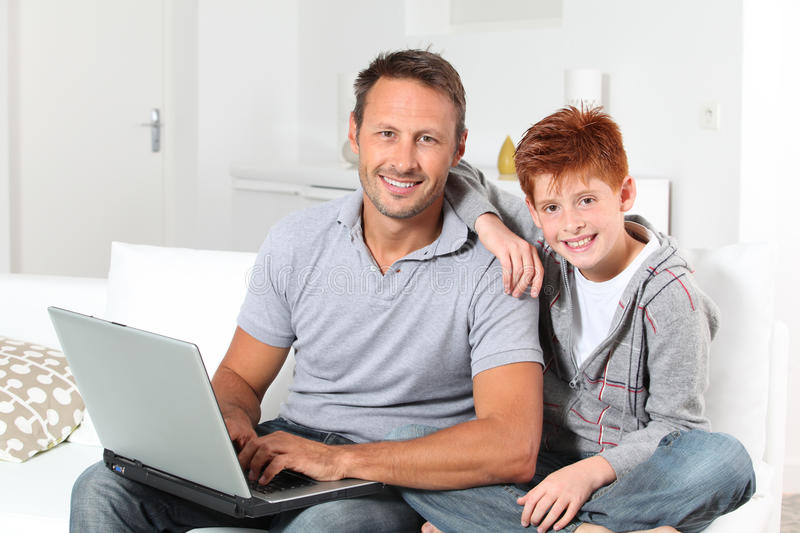 Father and son connected on internet royalty free stock image