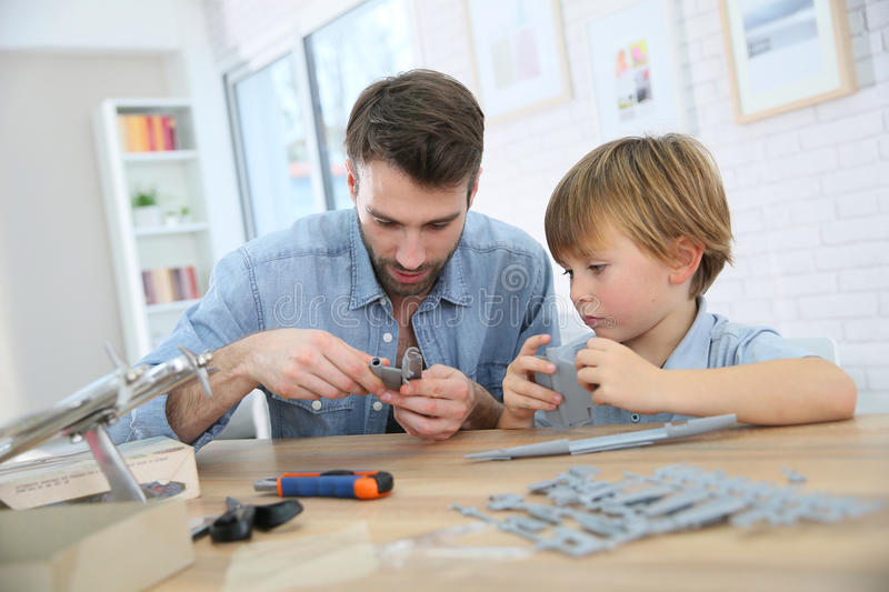 Father and son constructing an aeroplane toy stock photos