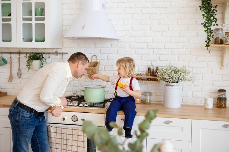 Father and son cooking together stock photography