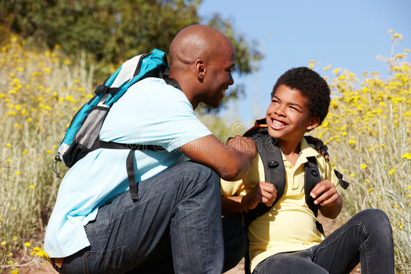 Download Father And Son On Country Hike Stock Image - Image of american, resting: 25430589