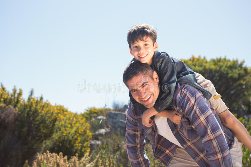 Father and son in the countryside royalty free stock image