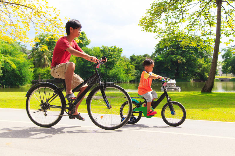 Father and son cycling stock image