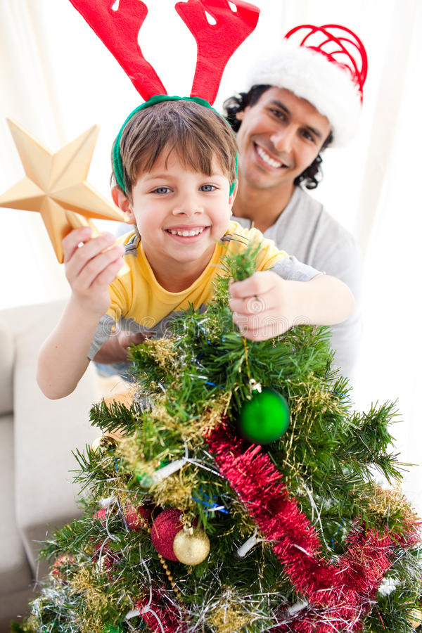 Download Father And Son Decorating A Christmas Tree Stock Image - Image: 11943331