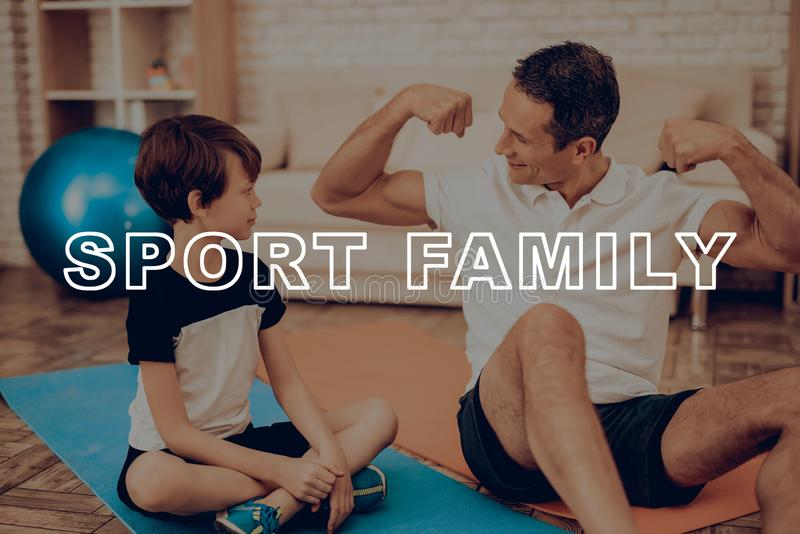 Father And Son Are Doing A Gym. Sport Family. Father And Son Are Doing Gym. Sport Family. Healthy Lifestyle. Active Holiday. Exercises Clothes. Getting Better stock image