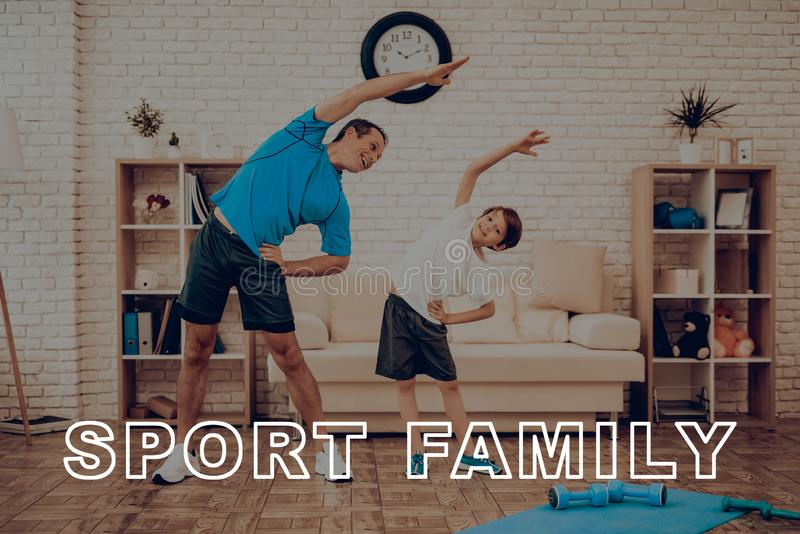 Father And Son Are Doing A Gym. Sport Family. Father And Son Are Doing Gym. Sport Family. Healthy Lifestyle. Active Holiday. Exercises Clothes. Getting Better royalty free stock photography