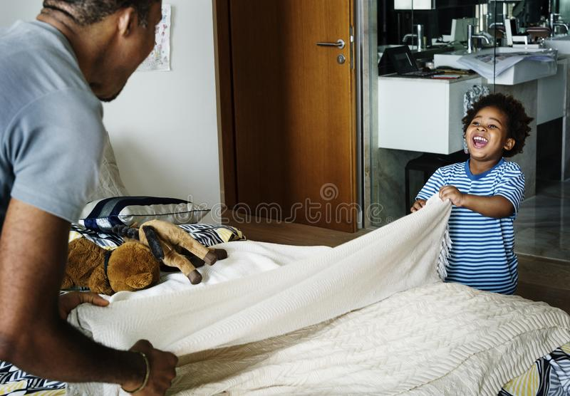 Father and son doing housework together stock photo