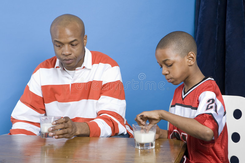 Father and son eating royalty free stock photo
