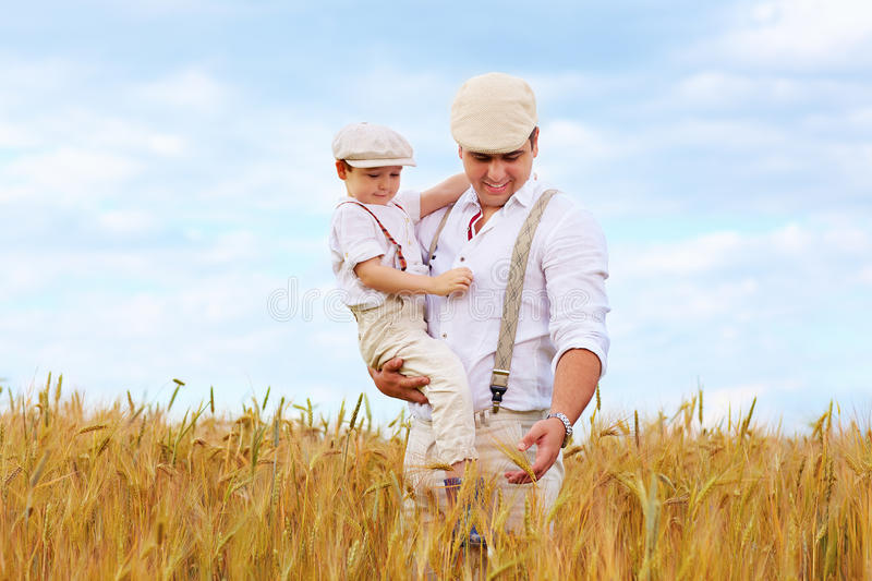 Father and son, farmers on wheat field royalty free stock photos