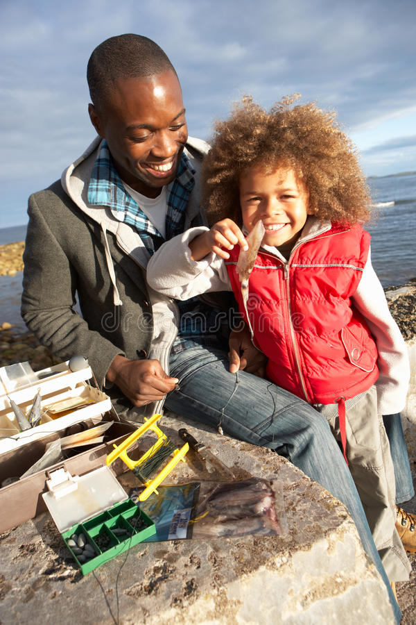 Father With Son Fishing Royalty Free Stock Photos