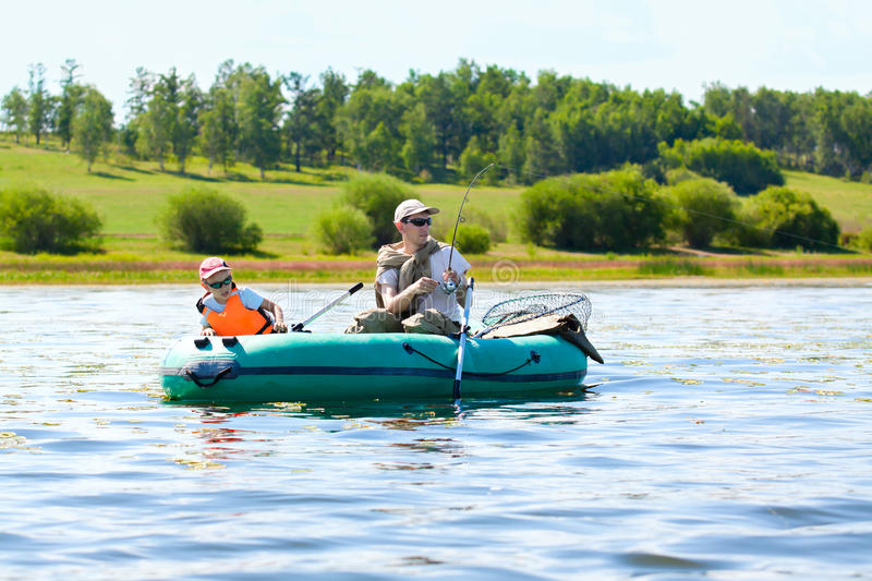 Father and son fishing stock photography