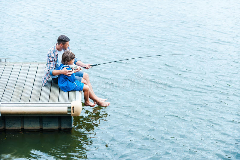 Father and son fishing. stock photos