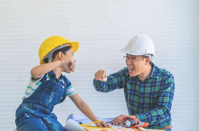 Father and Son fist bump for success concept in construction industry concept stock photo