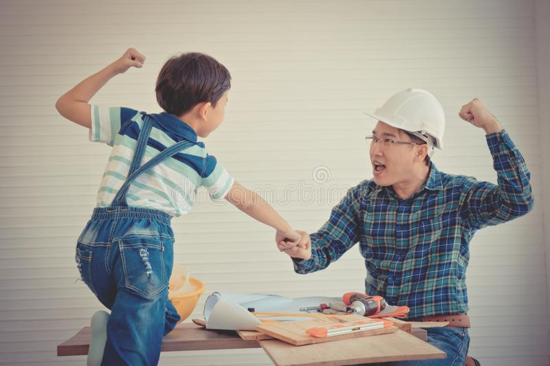 Father Son fist bump for success concept in construction industry concept in vintage tone stock images