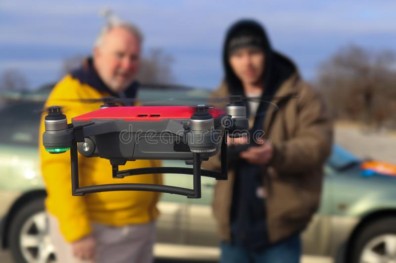 Father and son flying a DJI Spark drone Tulsa Oklahoma USA 12 - 28 - 2017. Father and son flying a DJI Spark drone in winter in Tulsa Oklahoma USA 12 - 28 - 2017 royalty free stock photo