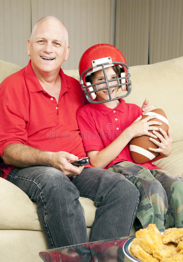 Download Father Son Football Fans stock photo. Image of polo, home - 17689278