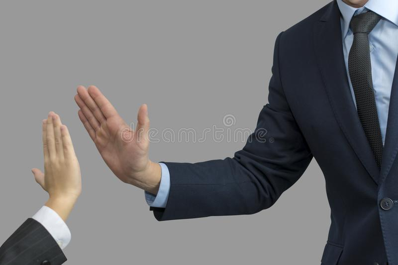 Father and son in formal wear giving high five.  royalty free stock photography