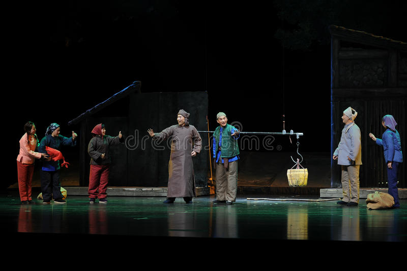 Father and son and friendly neighborhood - Jiangxi opera a steelyard. Jiangxi opera a steelyard is adapted from a true story: the last century fortys, the royalty free stock photography