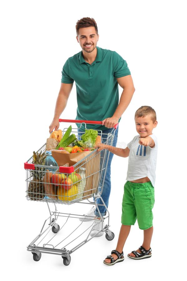 Father and son with full shopping cart on background royalty free stock photos