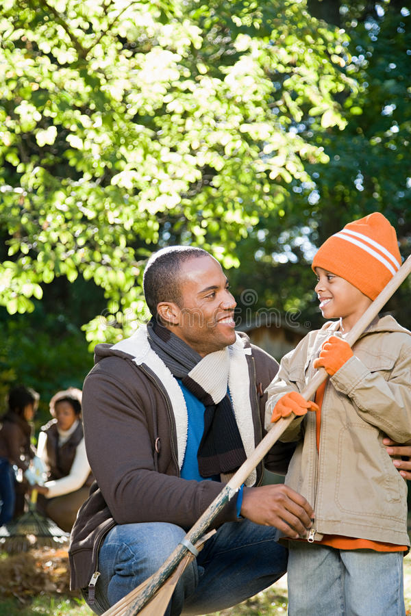 Father and son in garden royalty free stock photo