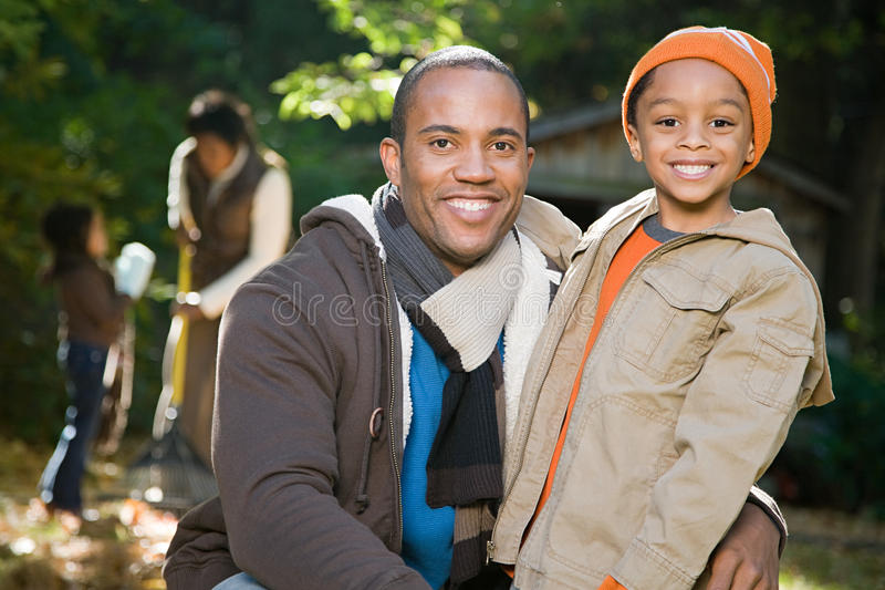 Father and son in garden royalty free stock image
