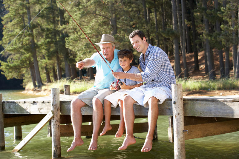Father,son and grandson fishing together stock image