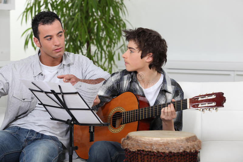 Download Father and son with guitar stock photo. Image of father - 29298010