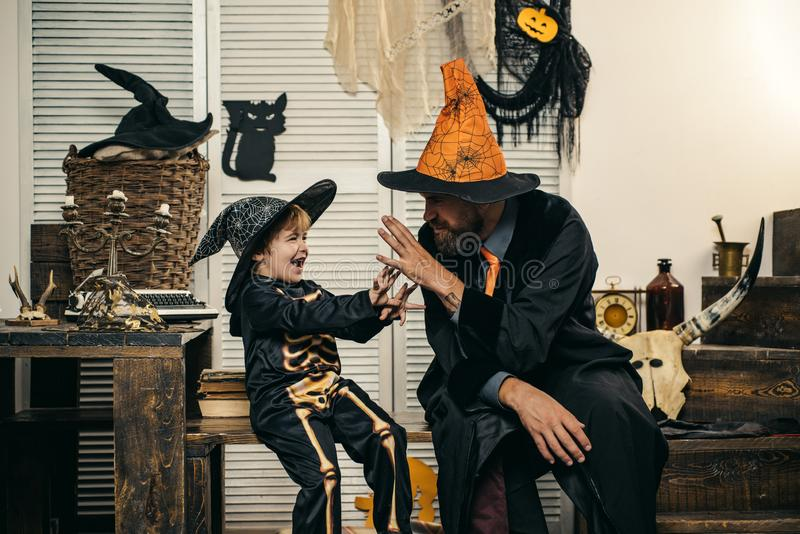 Father and son for Halloween. Happy autumn holiday. Halloween party costumes. Family fun. Game and play. royalty free stock photos