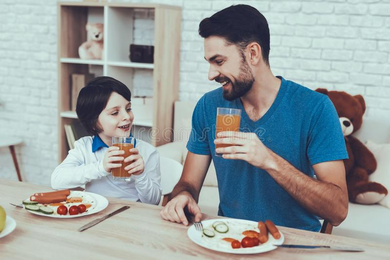 Father and Son Have a Breakfast royalty free stock photography