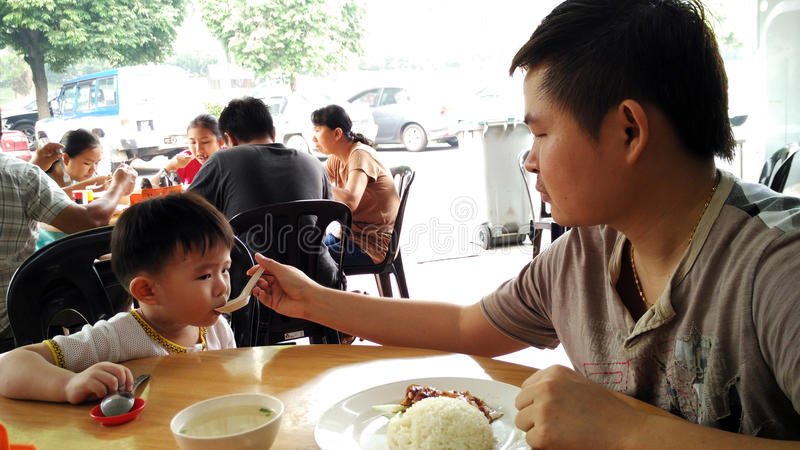 Father and son having breakfast stock image