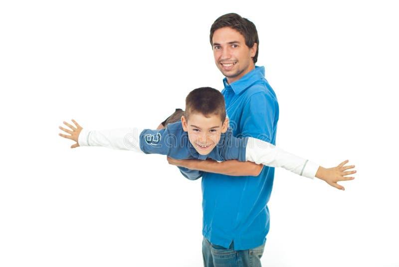Father and son having fun royalty free stock photos