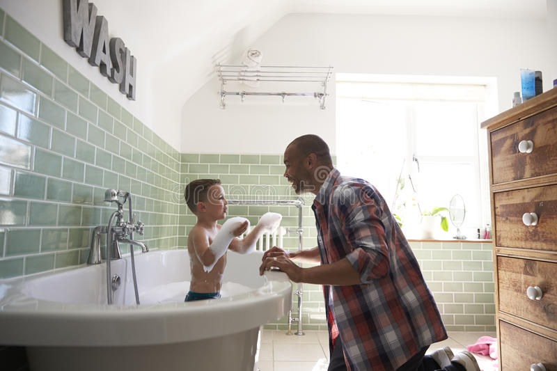 Father And Son Having Fun At Bath Time Together royalty free stock photo