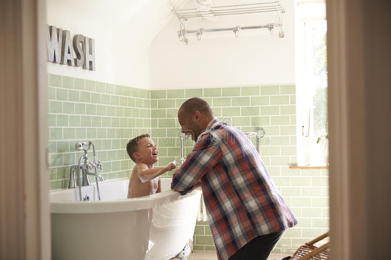 Father And Son Having Fun At Bath Time Together stock photo