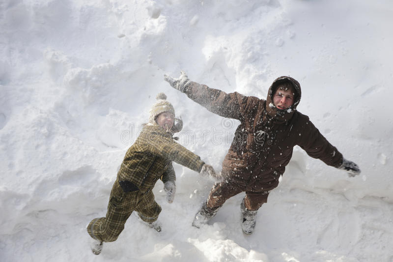Father and son having fun outdoors on winter holidays stock image