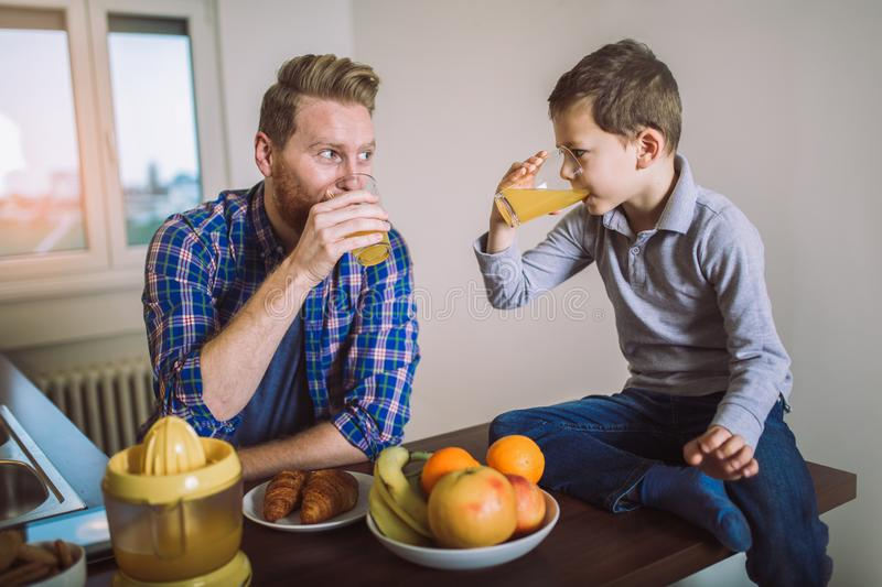 Father and son having healthy breakfast royalty free stock image