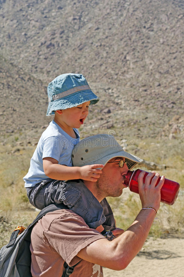Father and Son on a hike together stock image