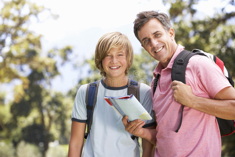 Father And Son Hiking Through Countryside royalty free stock photos