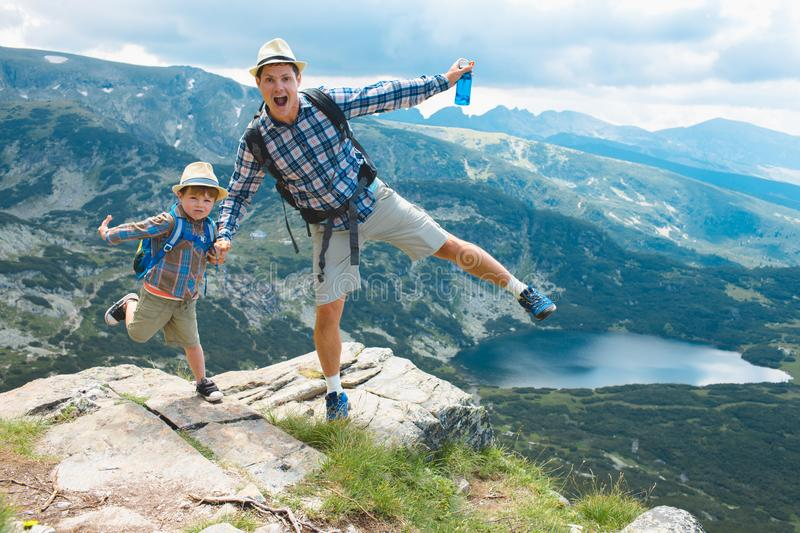 Father and son traveling in Rila mountains Bulgaria. Father and son hiking in Rila mountains, Bulgaria stock photography
