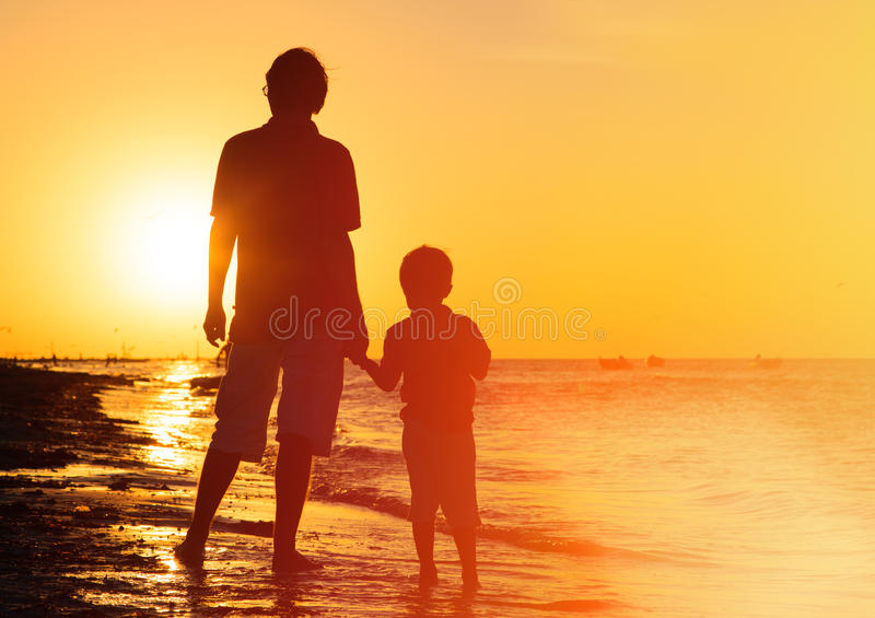 Download Father And Son Holding Hands At Sunset Stock Photo - Image of silhouette, relationship: 51666986
