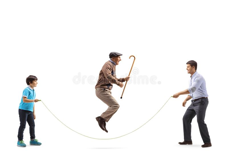 Father and son holding a rope and a grandfather skipping. Full length profile shot of a father and son holding a rope and a grandfather skipping isolated on royalty free stock photography