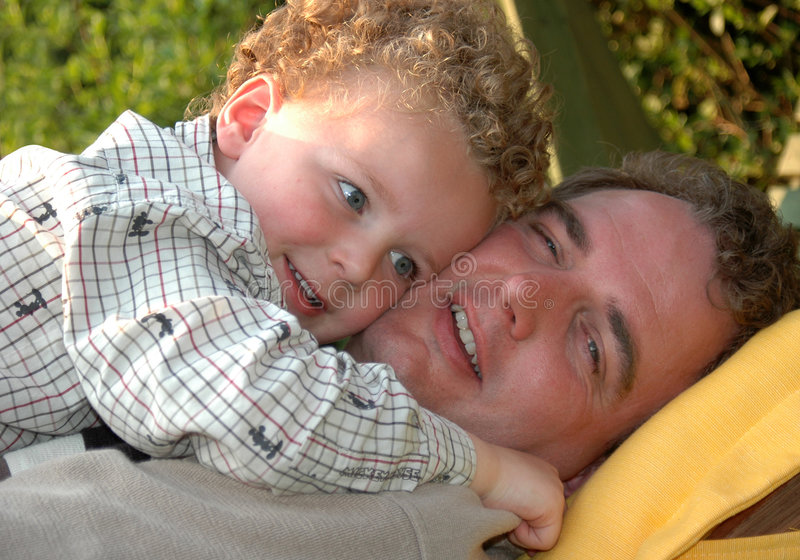 Download Father and Son Hugging stock image. Image of smiling, garden - 6036417