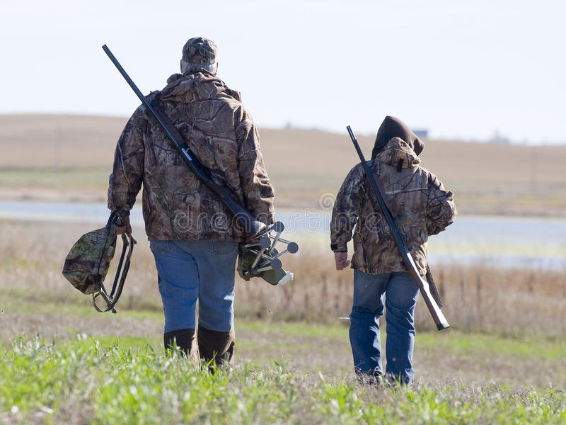 Father and Son hunters stock photo
