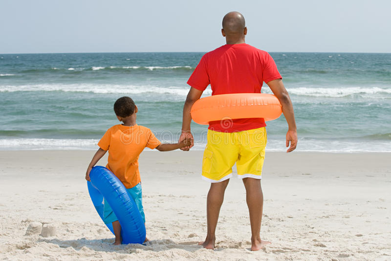 Father and son with inflatable rings stock photography
