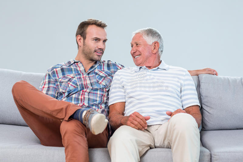 Father and son interacting with each other stock image