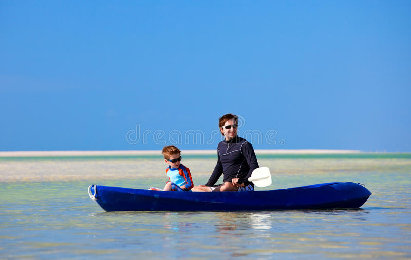 Download Father and son kayaking stock image. Image of water, enjoyment - 22100497